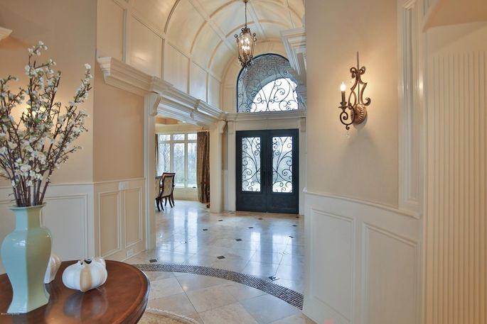 Foyer with travertine flooring