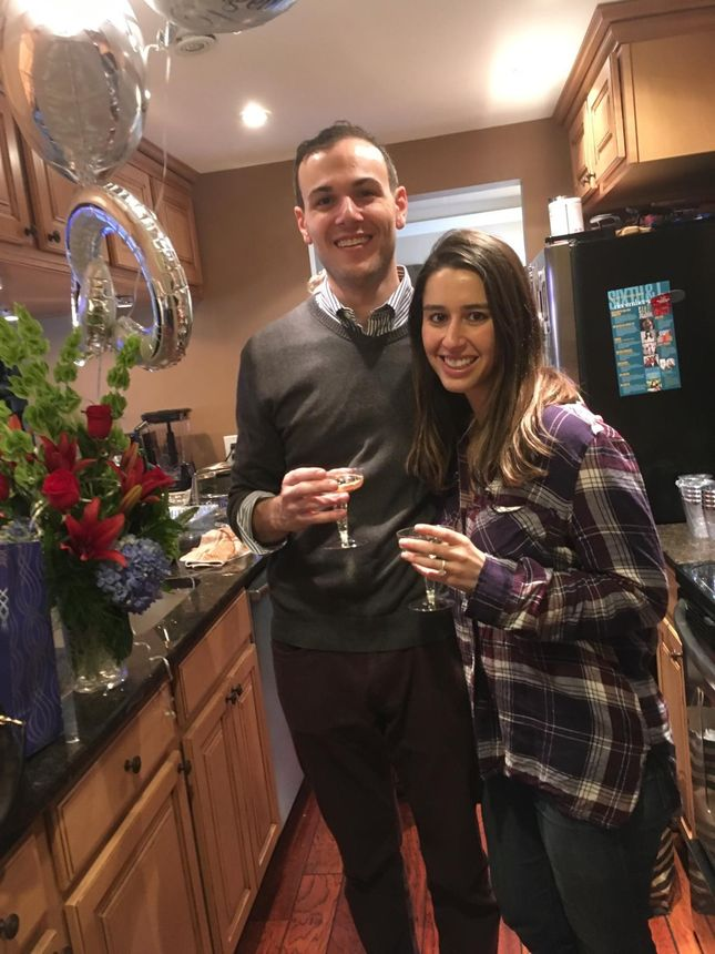 My fiancée and I celebrating our anniversary in our kitchen.