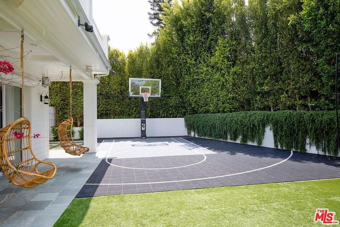 Sport court with basketball hoop