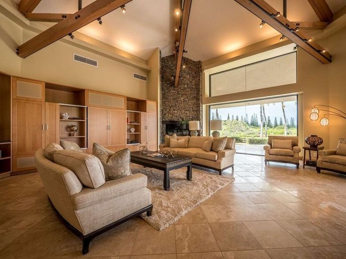 Living room with beams and stone fireplace