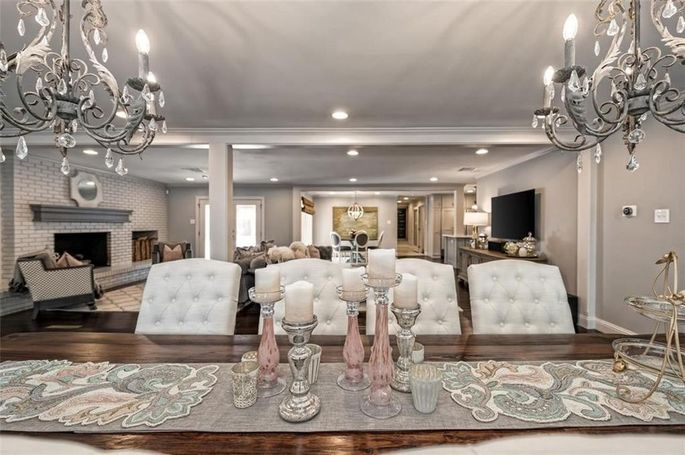 Recessed lighting and chic chandeliers were added.