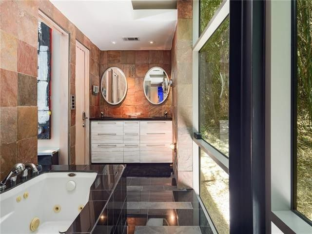 Bathroom walls lined with rough copper slate