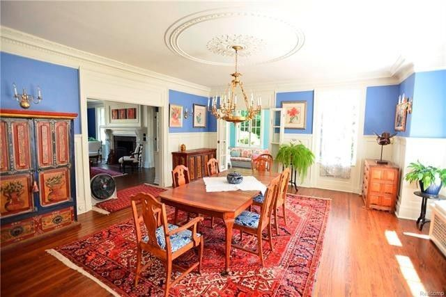 Dining room with wainscoting and ceiling medallion