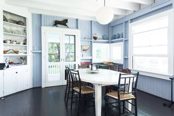 The blue plates in the dining room were once loaded as ballast in clipper ships full of tea from China by one of Mr. Cooper's seafaring ancestors.
