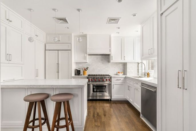 Kitchen with a breakfast bar and marble counters