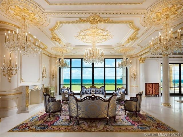 Does this sitting room really need five chandeliers?