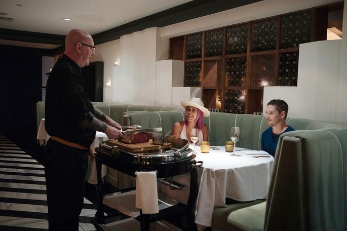 Herb Parrot serves Lorraine Lopez and Zach Bainter at Mr. Lyons restaurant in Palm Springs.