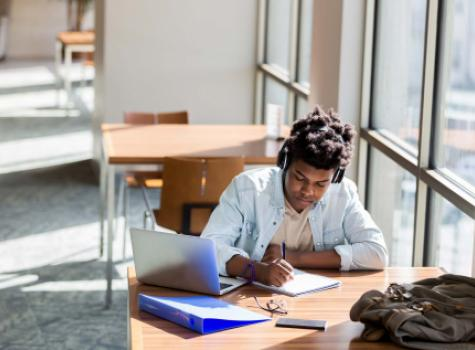 Young Black Student at Desk Working