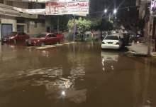 """Photo of بالصور.. شارع خدمة إجتماعية يغرق في شبر ونص """"انفجار ماسورة مياه"""""""