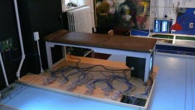 Image 15: VP2, Naccarato - Right Top Detail - TV Set, massage table, painted floor, coaxial cables