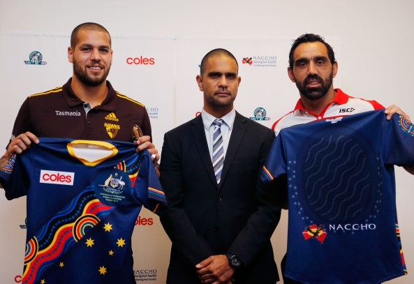 Lance Franklin, Michael O'Loughlin and Adam Goodes displaying the Indigenous All-Stars Guernsey during the event to announce the Indigenous Australian All Stars squad that will be eligible to play in the International Rules Series in Ireland, at the NCIE, Redfern, Sydney on August 29, 2013. (Photo: Anthony Pearse/AFL Media)