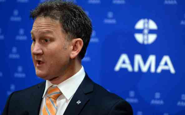 Newly elected Australian Medical Association (AMA) President Dr Michael Gannon speaks at a press conference at the National Convention Centre in Canberra, Sunday, May 29, 2016. (AAP Image/Mick Tsikas) NO ARCHIVING