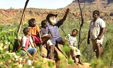 Aboriginal elder of Nyikina country, John Watson show grandchildren his special lands in WA's Kimberley area