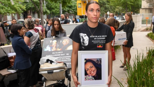 Daughters Apryl Watson and Kimberly Watson with photos of their mother Tanya Day outside Coroners Court.