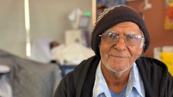 portrait of Donald 'Bluey' Roberts in hospital ward