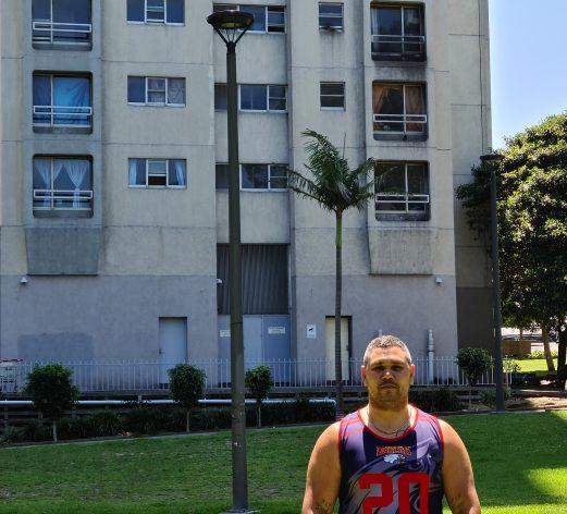 Keenan Mundine in sleeveless t-shirt standing outside The Block
