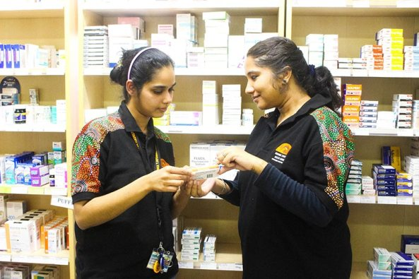 two Aboriginal health workers at Umoona Tjutagku Health Service AC checking medicine box