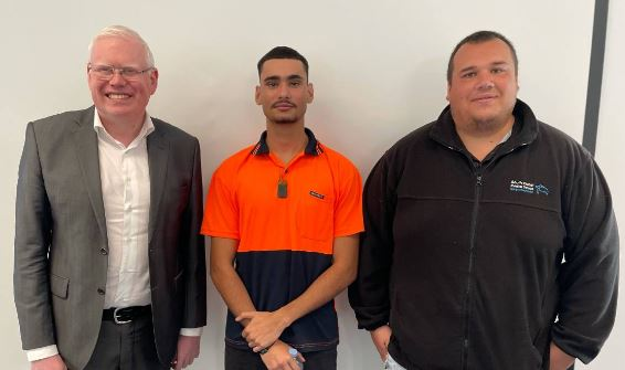 Tyrone Walter standing between his caseworker Jordan Farrell, and the Minister for Families, Communities and Disability Services Gareth Ward