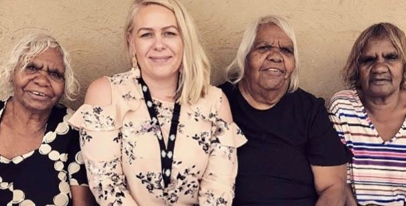 Simone Kenmore & 3 of her Aunties in Alice Springs standing together against rendered wall