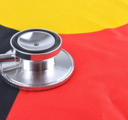 stethoscope on Aboriginal flag