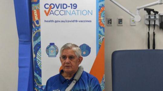 Min Ken Wyatt against DoH COVID-19 Vaccination health.gov.au/covid19-vaccines banner