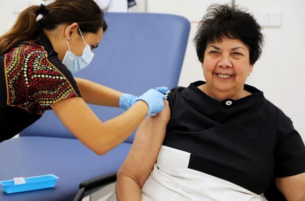 Dr Dawn Casey Deputy CEO NACCHO receiving COVID-19 vaccine