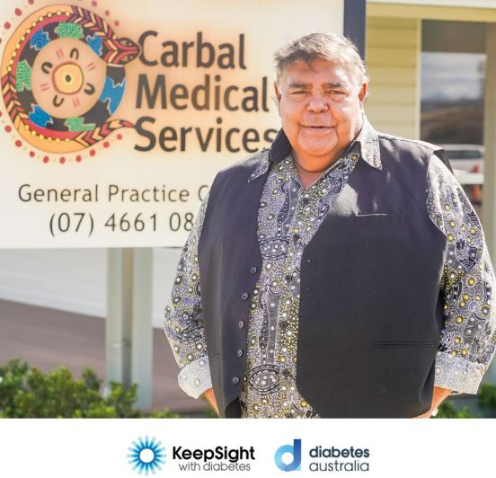 country singer Roger Knox standing in front of Carbal Medical Services sign