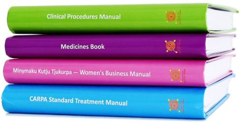 4 Remote PHC Manuals stacked, blue, pink, purple, green