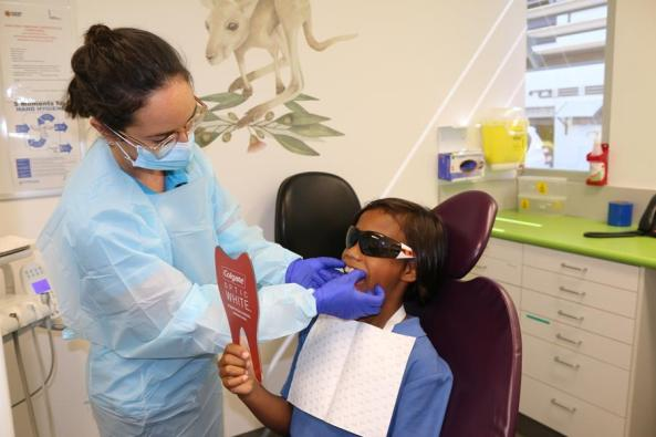10-year-old Jamal Van Den Berg Hammer gets his mouthguard fitted by NT Health Oral Health Therapist Lauren Cross.