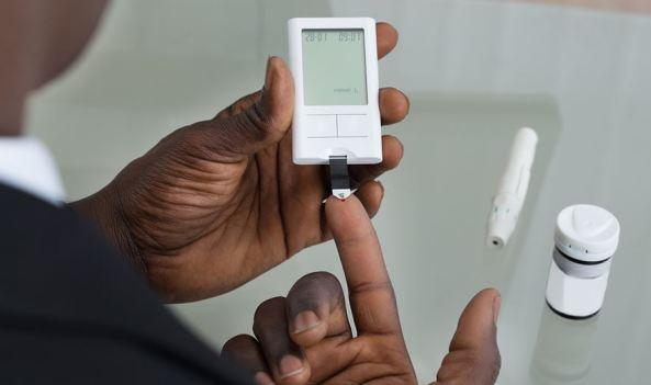 Aboriginal person's hands, blood sugar level testing