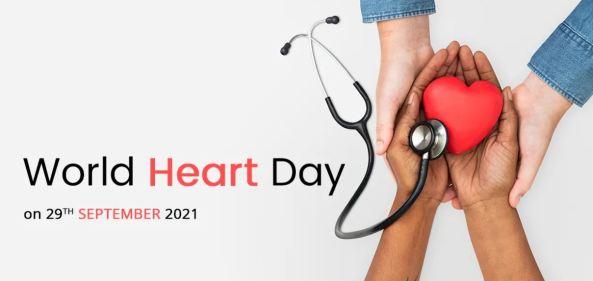 banner text 'World Heart Day' 29 September 2021 - white & black hands hold red plastic heart & stethoscope