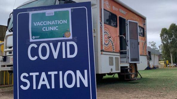 Health on Wheels covid vax clinic van & sign