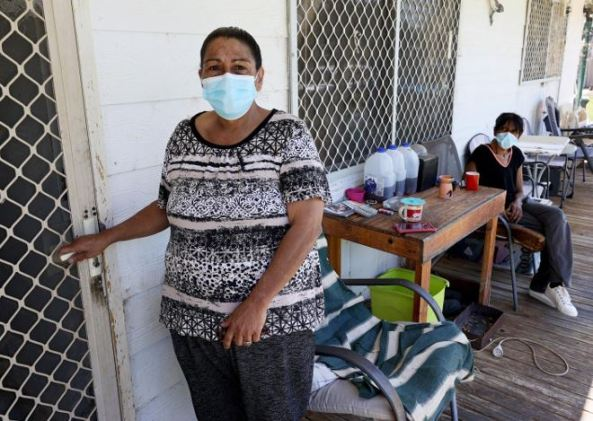 Wilcannia residents Aunty Sissy King and sister Tammy on the verandah of their home