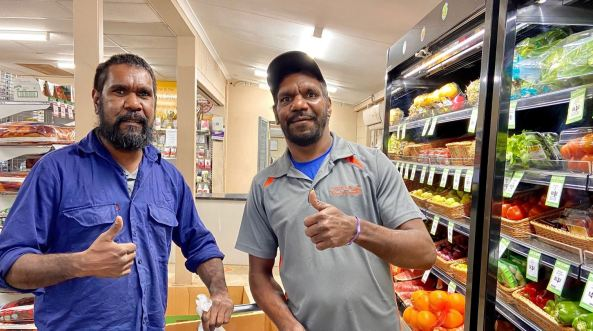 two Aboriginal male store workers Ali Curung
