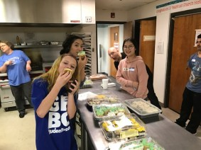 ShinYoung and Host Sister help at a homeless dinner.