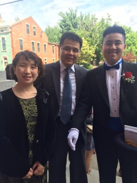 Jingjie Lin (Villa Madonna) along side his mother and father - graduation