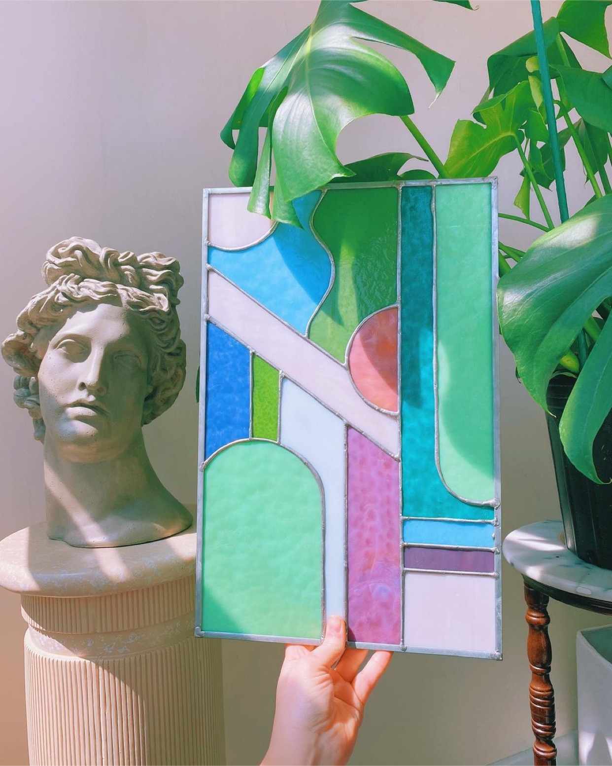 Large stained glass piece. glass is beach colors in mint green, lavender, and pink