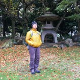 Robin stands beside Japanese garden with stone lantern in back yard