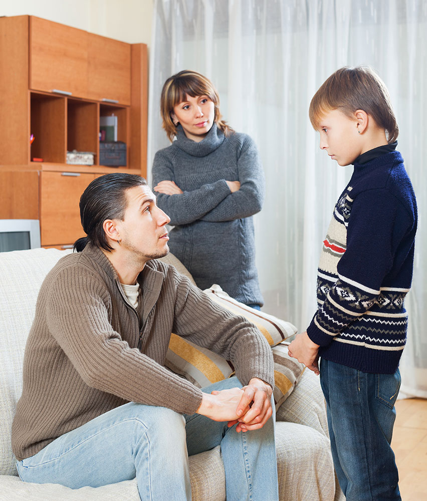three ways to get your children to obey you - bad behaviour - listen to your parents - Correct your children behaviour -kids to obey Father advising his son as his mother watches