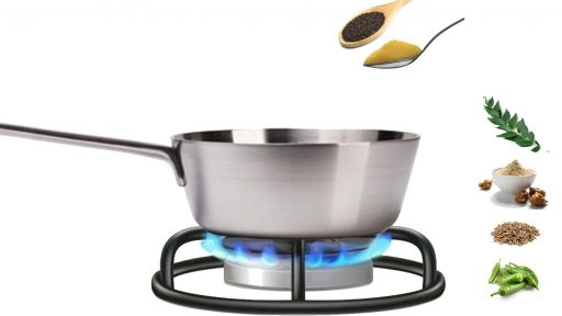 pan on stove and spoons with ghee and mustard
