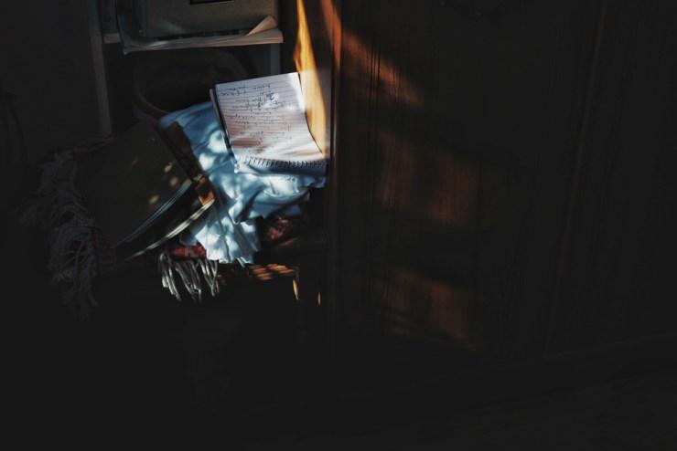 light photography light spot on pile of notebooks