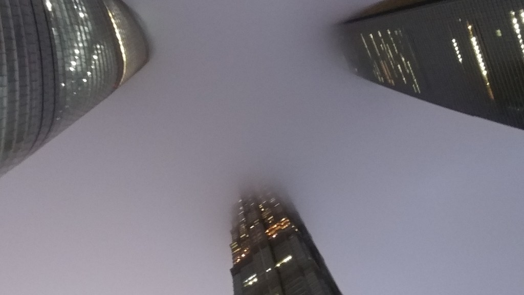 The view from below Shanghai Tower on a cloudy evening.