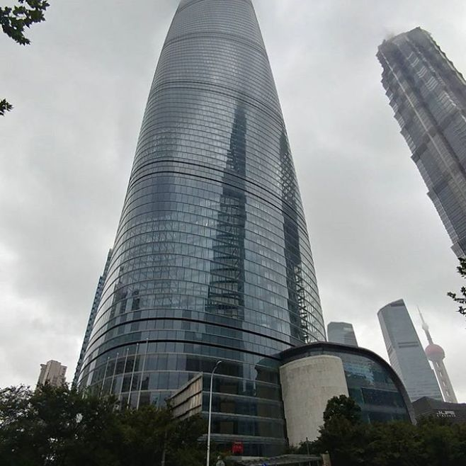 Next stop: Shanghai Tower. Tallest building in Asia. At 128 stories it's the second tallest building in the world with the tallest observation deck in the world. So tall you can't see the top on this rainy day.