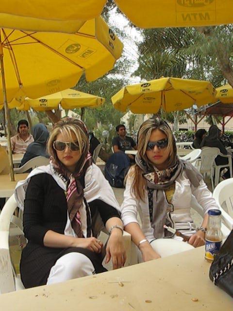 Leila-Pazooki-Two-Girls-Smoking-Shishah-at-Tea-House-by-the-Beach-in-Kish-Island-Iran-2009.jpg