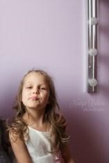 Funny girl's portrait indoors