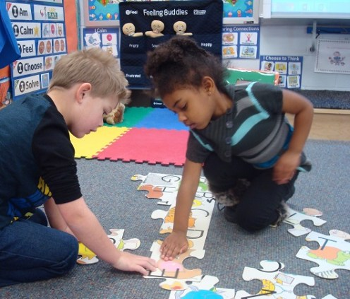 children playing with puzzle