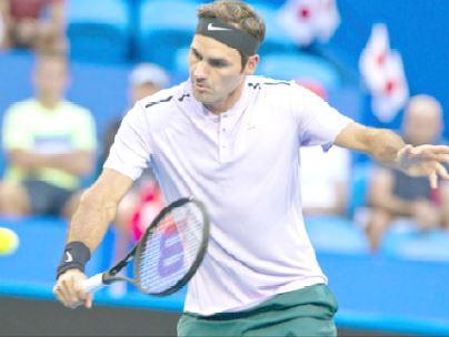 Federer breezes through opener in Melbourne