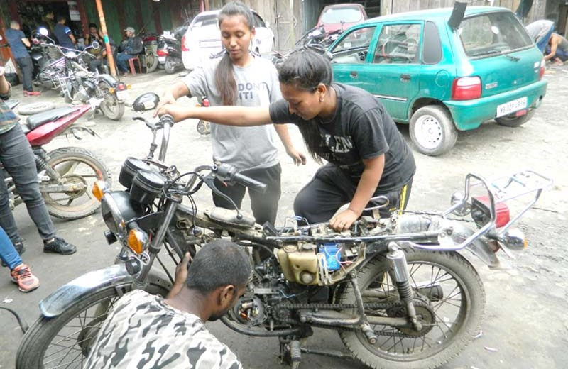 Pongam and Nginlei – first two lady  bike mechanics in Nagaland