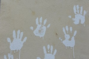 child's hand prints in blue paint