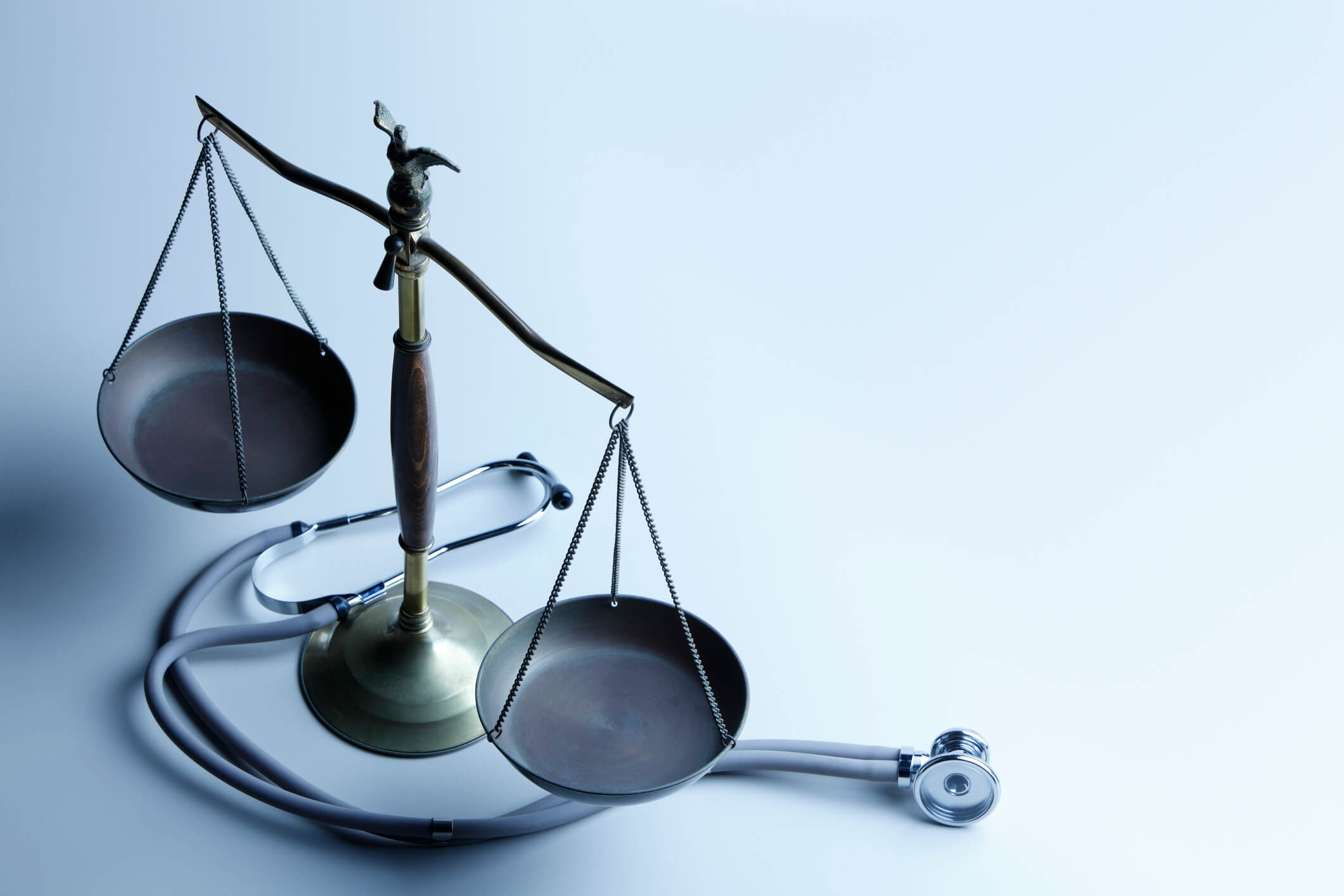 A stethoscope and a scale, signifying medical malpractice cases.